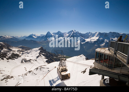 Overhead cable car arriving Piz Gloria and top station of the Schilthornbahn (location for James Bond novel and - Stock Photo