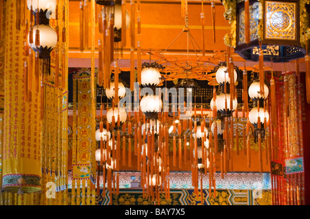 Colourful Chinese Lanterns hanging from the ceiling inside the Hall of the Great Hero at Po Lin Monastery. - Stock Photo