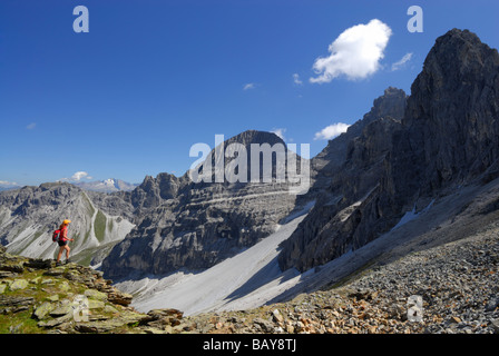 young woman hiking in front of Tribulaun range, Stubaier Alpen range, Stubai, Tyrol, Austria - Stock Photo