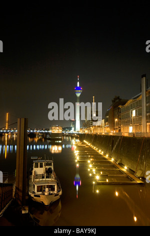 Modern architecture of the Media Harbour at night with television tower, Neuer Zollhof, Duesseldorf, state capital - Stock Photo