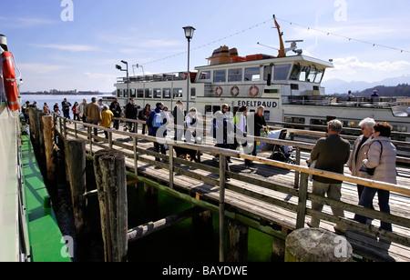 Tourist on Wooden Ferry Boat Jetty Herreninsel Chiemsee Chiemgau Bavaria Germany - Stock Photo
