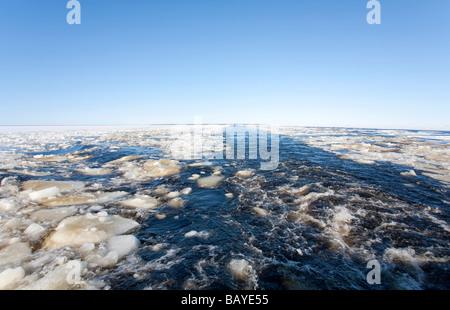 Breaking ice on ship's wake at Baltic Sea , Gulf of Bothnia , Finland - Stock Photo