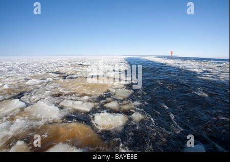 Breaking sea ice on ship's wake at Baltic Sea , Gulf of Bothnia , Finland - Stock Photo