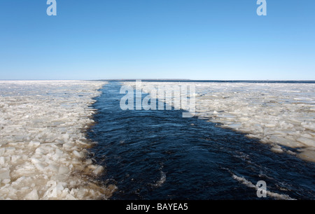 Breaking sea ice on ship's wake at Baltic Sea , Gulf of Bothnia , Finland - Stock Photo