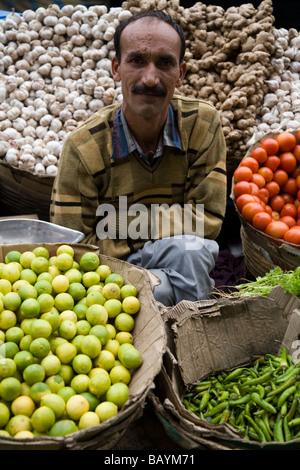 Street seller with his fresh fruit, garlic, and ginger market stall. Shimla. Himachal Pradesh. India. - Stock Photo