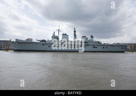 LONDON, ENGLAND - MAY 09: HMS Illustrious, the UK's strike aircraft carrier, moored on the river Thames at Greenwich. - Stock Photo