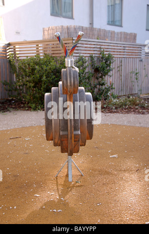 A wooden riding toy in a local children's community play ground at Colindale, London, England, Uk - Stock Photo