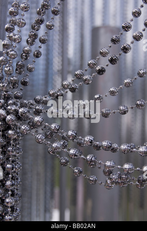 Strings of mini disco balls draped as stage prop. - Stock Photo