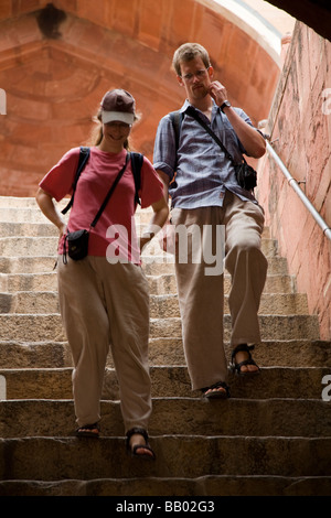 Western tourists on steps within the Tomb of Emperor Humayun (Humayun's tomb). Delhi, India. - Stock Photo