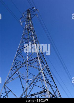 View looking up to the top of a large electricity pylon, England, UK - Stock Photo