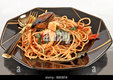 Spaghetti marinara pasta with seafood mussels prawns squid - Stock Photo