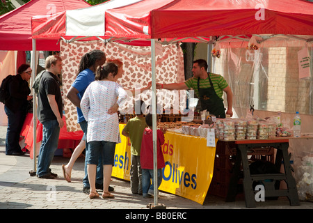 market stall selling olives in Putney London UK - Stock Photo