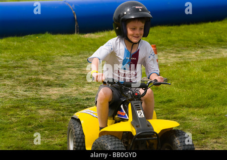 Young Boy Child Youngster Riding a Quad Bike - Stock Photo