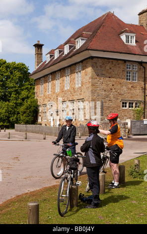 UK Gloucestershire Forest of Dean cyclists resting outside the Speech House Hotel - Stock Photo
