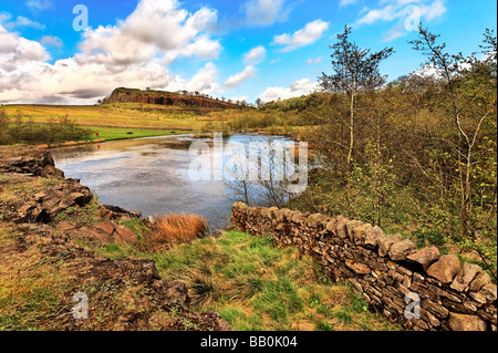 Lake on the site of the disused quarry on the line of Hadrian's Wall at Walltown Crags Cumbria - Stock Photo