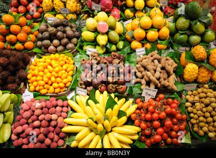 Fruits stand in La Boqueria market, Barcelona Spain - Stock Photo