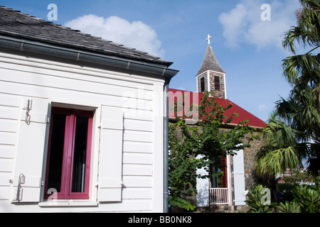 Wooden house and St Bartholomews Anglican Church Gustavia St Barts - Stock Photo