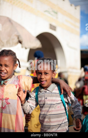 Children in front of Harar Gate in the Christian Market of Old Harar in Eastern Ethiopia - Stock Photo