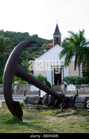 Old anchor opposite St Bartholomews Anglican Church Gustavia St Barts - Stock Photo