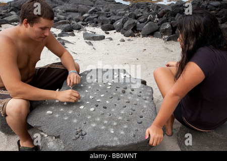 Teenagers playing konane - Stock Photo