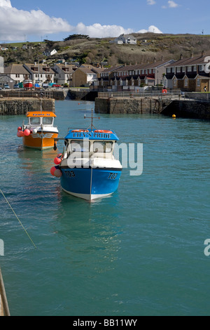 Colourful boats in Portreath harbour at high tide, Cornwall UK. - Stock Photo
