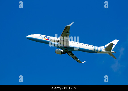 Twin engined Embraer ERJ-190-2000-195LR Flybe Civil Airliner departing Inverness  Airport Highland Scotland - Stock Photo