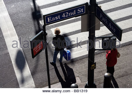 people waiting to cross a zebra crossing NYC Park Avenue and East 42nd street - Stock Photo