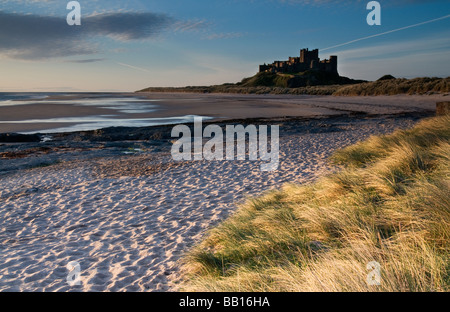 Bamburgh Castle pictured in early morning light - Stock Photo