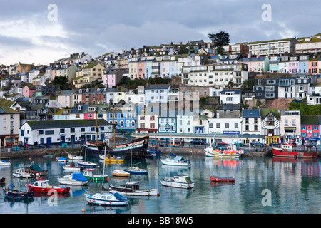 Fishing vessels and small yachts accompany the Golden Hind at anchor in Brixham Harbour South Devon England January - Stock Photo