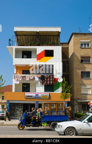 Traffic and brightly painted buildings in Tirana Albania Europe - Stock Photo