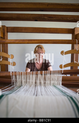 Woman weaving at Nellis Tavern historic site textile and fabric show St Johnsville New York state Montgomery County - Stock Photo