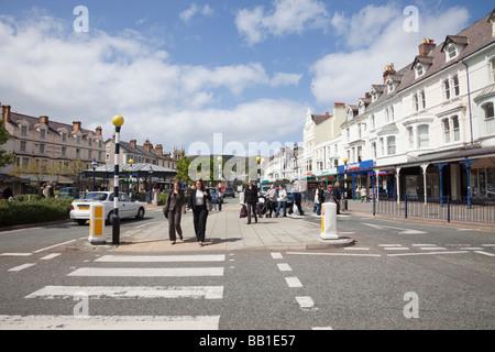 Pedestrian crossing and view down Mostyn Street, Llandudno, Conwy, North Wales, UK, Britain - Stock Photo