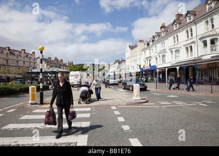 Mostyn Street Llandudno Conwy North Wales UK Europe People using a Pedestrian Crossing on the High Street - Stock Photo