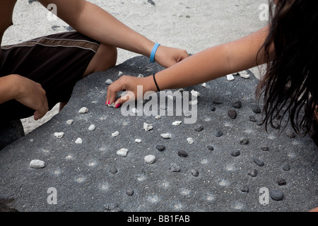Konane game hawaiian checkers - Stock Photo