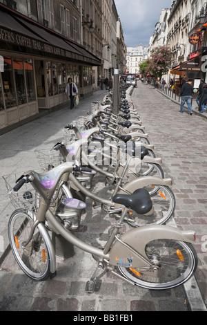 Row of Velib hire bicycles in Paris street - Stock Photo