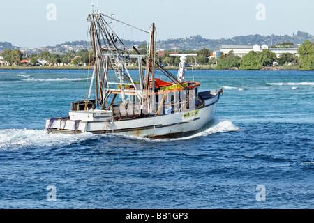 Fishing Trawler navigating a waterway - Stock Photo
