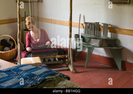Woman weaving with Iroquois style loom at Nellis Tavern historic site textile fair New York state Mohawk Valley - Stock Photo