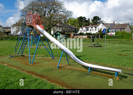 an empty childrens slide in a playground in cornwall,uk - Stock Photo