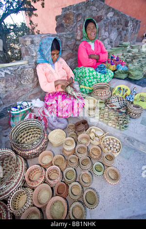Tarahumara native Indian women sit with woven baskets that she makes and sells to tourists Divisadero, Copper Canyon, - Stock Photo