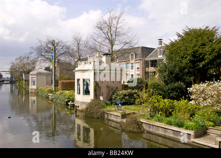 Europe, Netherlands, North Holland, Edam, Homes along canal - Stock Photo