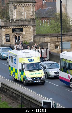 Ambulance speeding through heavy city centre traffic in York - Stock Photo
