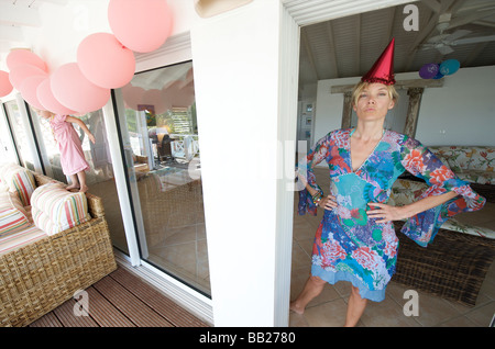 Sint Maarten mother at birthday party of four year old - Stock Photo