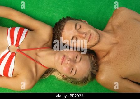 High angle view of a couple sunbathing - Stock Photo