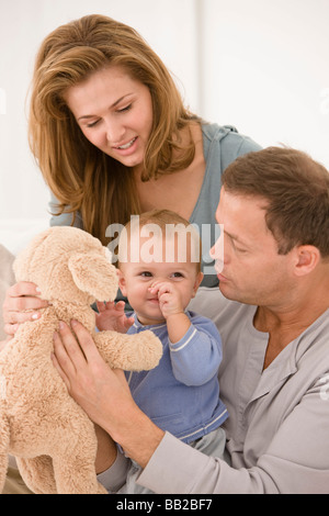 Parents playing with their daughter - Stock Photo