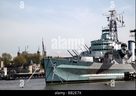Shot of the HMS Belfast with the Tower of London in the Background - Stock Photo