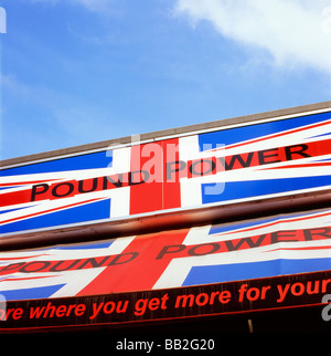Pound Power strong sterling sign on a high street shop store advertisement ad advert London England UK  KATHY DEWITT - Stock Photo
