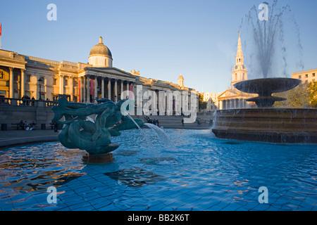 Fountains at Trafalgar Square, City of London England United Kingdom - Stock Photo