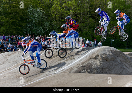 Six racing competitors at the BMX Supercross World Cup - Stock Photo