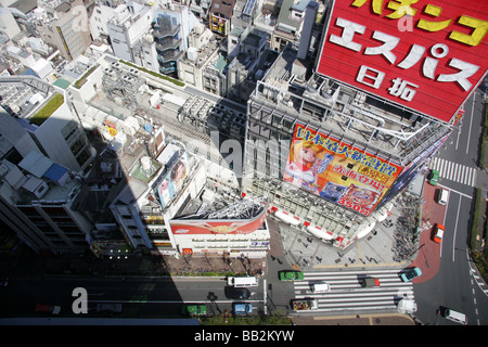 Buildings and street in the Shinjuku District of Tokyo Japan - Stock Photo