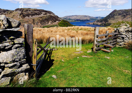English Lake District, looking down to Ullswater from a gateway on the slopes of Helvellyn above the village of - Stock Photo